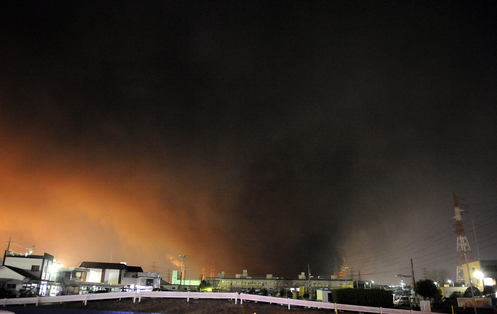 . Black smoke rises from an oil industrial complex caused by the massive 8.9-magnitude earthquake in Ichihara city, Chiba prefecture on March 11, 2011. The earthquake shook Japan, unleashing powerful tsunamis that sent ships crashing into the shore and carried cars through the streets of coastal towns. (TOSHIFUMI KITAMURA/AFP/Getty Images)