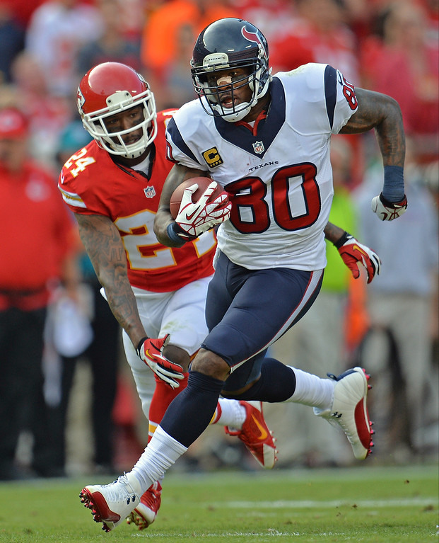 . Wide receiver Andre Johnson #80 of the Houston Texans rushes past defensive back Brandon Flowers #24 of the Kansas City Chiefs during the first half on October 20, 2013 at Arrowhead Stadium in Kansas City, Missouri.  (Photo by Peter Aiken/Getty Images)