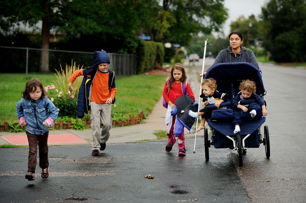 . From left, Olivia, 4, Gavin, 9, and Sienna, 8, walk home from school with their mother, Ena, and 2 year-old-twin brothers, Noah and Roman. Ena and Brent Batron are both blind, and raising five kids under the age of 10.  Photo by Jamie Cotten, Special to The Denver Post