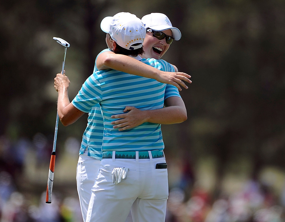 . PARKER, CO - Aug.17: Team Europe\'s Caroline Masson, facing camera, and Catriona Matthew celebrate on the 18th. The 2013 Solheim Cup takes place at the Colorado Golf Club with the USA taking on Europe in the Saturday morning Foursomes Match. (Photo By Kathryn Scott Osler/The Denver Post)