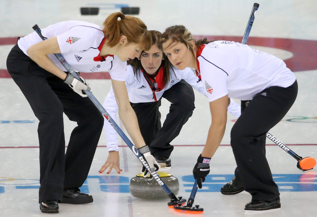 . Eve Muirhead (C) of Great Britain delivers a stone as Vicki Adams (R) and Claire Hamilton (L) sweep during the Round Robin match between Sweden and Great Britain of the Women\'s Curling competition in the Ice Cube Curling Center at the Sochi 2014 Olympic Games.  EPA/TATYANA ZENKOVICH