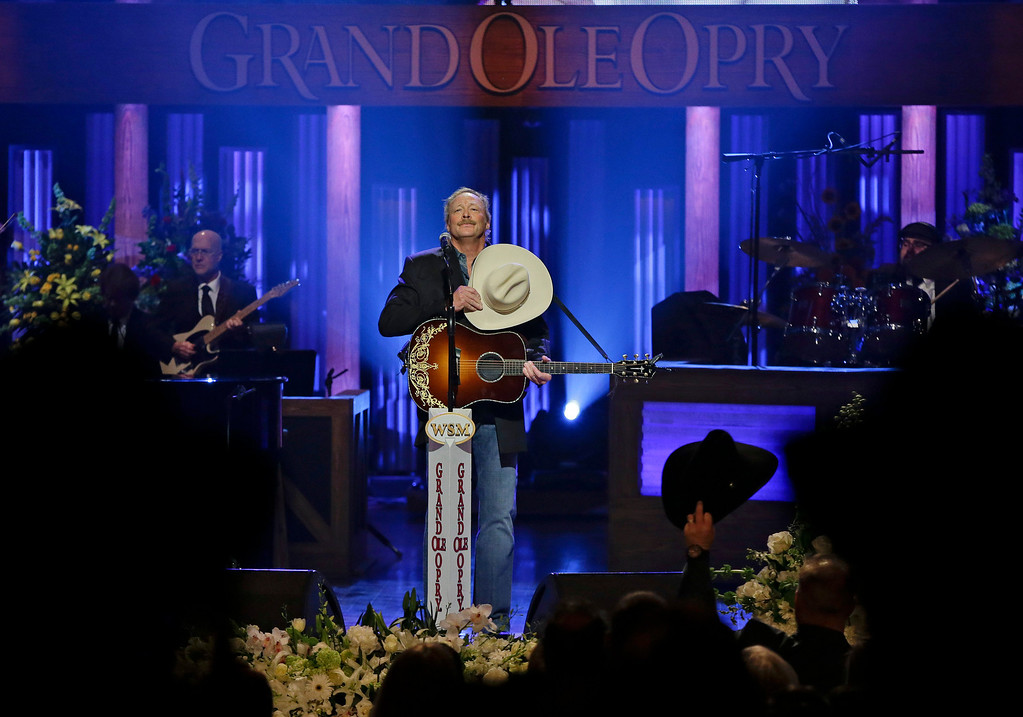 ". Alan Jackson is cheered after performing ""He Stopped Loving Her Today\"" to close the funeral for country music star George Jones in the Grand Ole Opry House on Thursday, May 2, 2013, in Nashville, Tenn. Jones, one of country music\'s biggest stars who had No. 1 hits in four separate decades, died April 26.  (AP Photo/Mark Humphrey, Pool)"