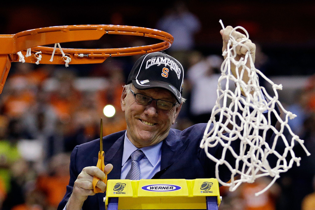 . Head coach Jim Boeheim of the Syracuse Orange cuts down the net after defeating the Marquette Golden Eagles to win the East Regional Round Final of the 2013 NCAA Men\'s Basketball Tournament at Verizon Center on March 30, 2013 in Washington, DC.  (Photo by Rob Carr/Getty Images)
