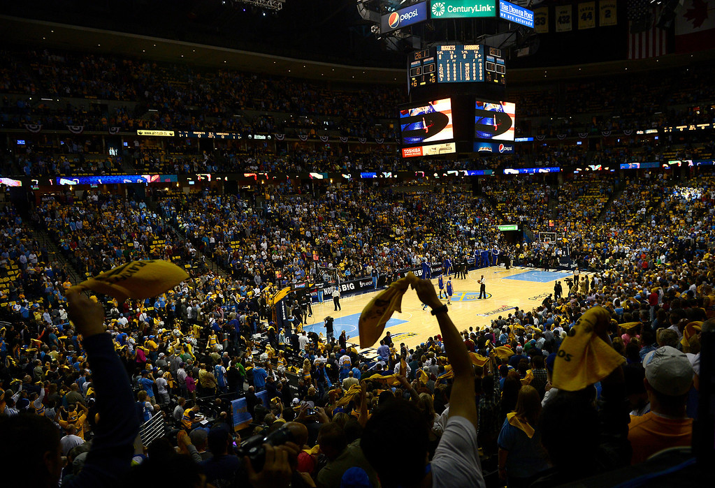 . DENVER, CO. - APRIL 20: Nuggets fans wave their yellow towels during the first quarter. The Denver Nuggets took on the Golden State Warriors in Game 1 of the Western Conference First Round Series at the Pepsi Center in Denver, Colo. on April 20, 2013. (Photo by AAron Ontiveroz/The Denver Post)