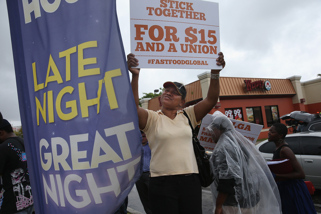 . Selmira Wilson who said she works for McDonald\'s joins in a fast food workers protest in front of a Wendy\'s restaurant on May 15, 2014 in Miami, Florida.  (Photo by Joe Raedle/Getty Images)