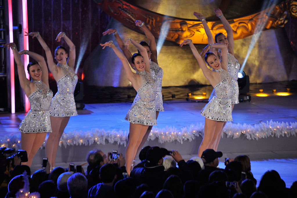 ". Members of the musical ""Rockettes\"" perform during 81st Annual Rockefeller Center Christmas Tree Lighting Ceremony at Rockefeller Center on December 4, 2013 in New York City.  (Photo by Stephen Lovekin/Getty Images)"