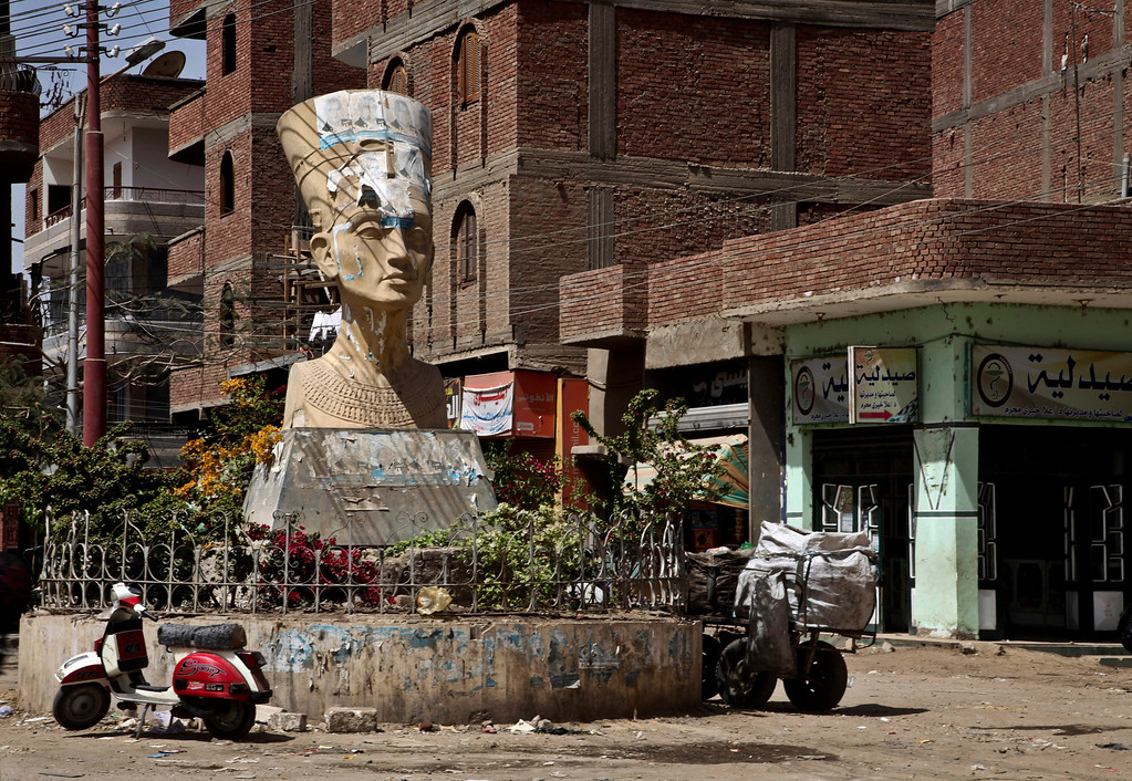 . In this Wednesday, March 27, 2013 photo, A defaced statue of Nefretti, adorns the intersection of the main street in Samalout, Minya Province, Egypt. Egypt\'s Christians, followers of one of the world\'s most ancient churches, make up about 10 percent of the country\'s estimated 90 million people.  (AP Photo/Thomas Hartwell)