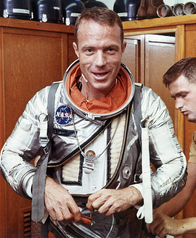 . Astronaut Scott Carpenter has his space suit adjusted by a technician in Cape Canaveral, Fla. on Aug. 1962. Carpenter, the second American to orbit the Earth and one of the last surviving original Mercury 7 astronauts, died Thursday, Oct. 10, 2013. He was 88. (AP Photo, File)