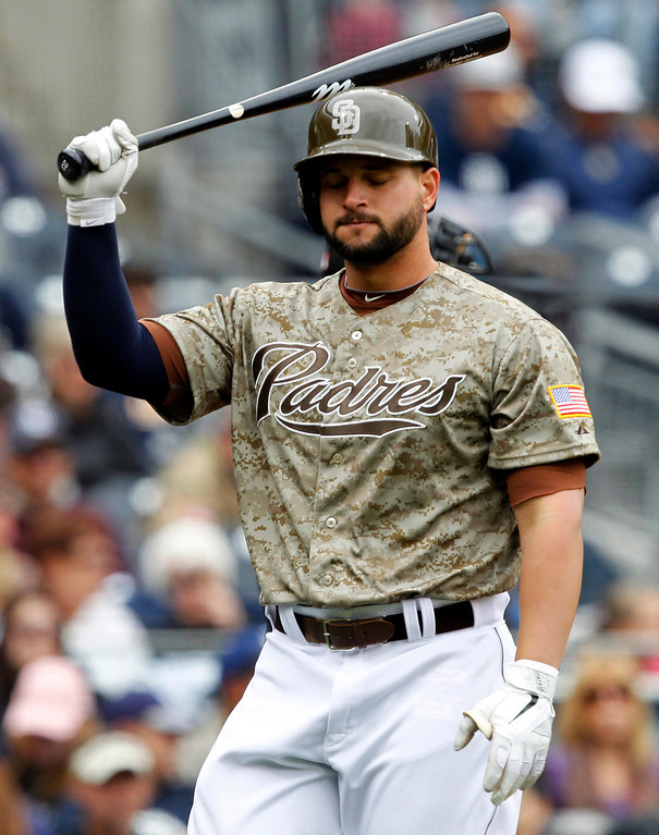 . San Diego Padres\' Yonder Alonso reacts after striking out in the sixth inning against the Colorado Rockies during a baseball game, Sunday, April 14, 2013, in San Diego. (AP Photo/Alex Gallardo)