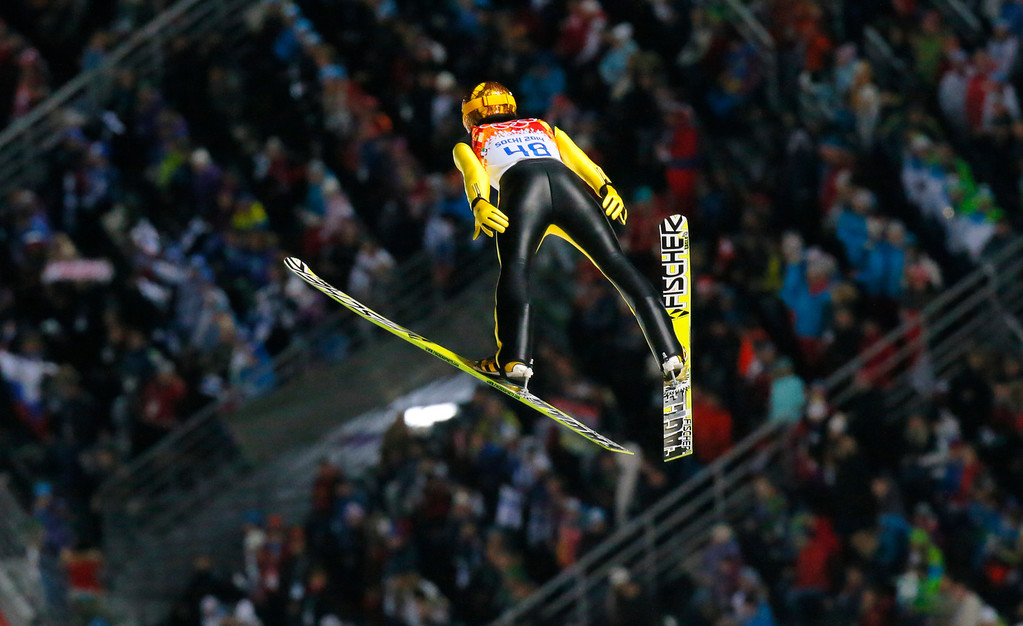 . Japan\'s Noriaki Kasai makes his first attempt during the ski jumping large hill final at the 2014 Winter Olympics, Saturday, Feb. 15, 2014, in Krasnaya Polyana, Russia. (AP Photo/Dmitry Lovetsky)