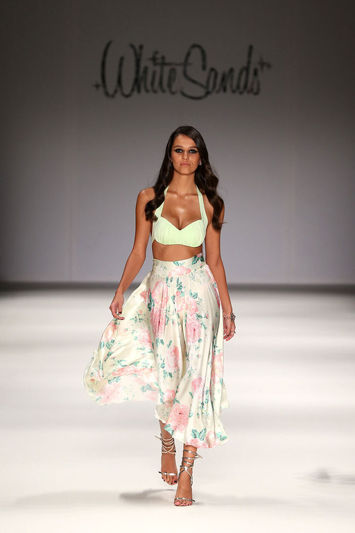 . A model showcases designs on the runway at the White Sands show during Mercedes-Benz Fashion Week Australia Spring/Summer 2013/14 at Carriageworks on April 8, 2013 in Sydney, Australia.  (Photo by Brendon Thorne/Getty Images)
