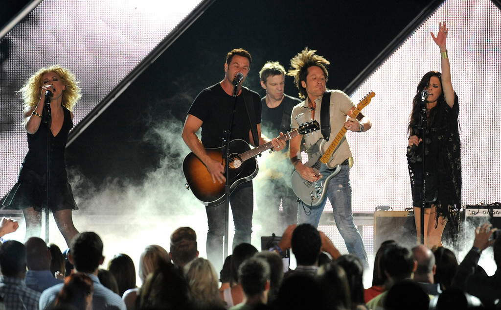 . Keith Urban, second from right, and from left, Kimberly Schlapman, Jimi Westbrook and Karen Fairchild, of Little Big Town, perform at the 2013 CMT Music Awards at Bridgestone Arena on Wednesday, June 5, 2013, in Nashville, Tenn. (Photo by Donn Jones/Invision/AP)