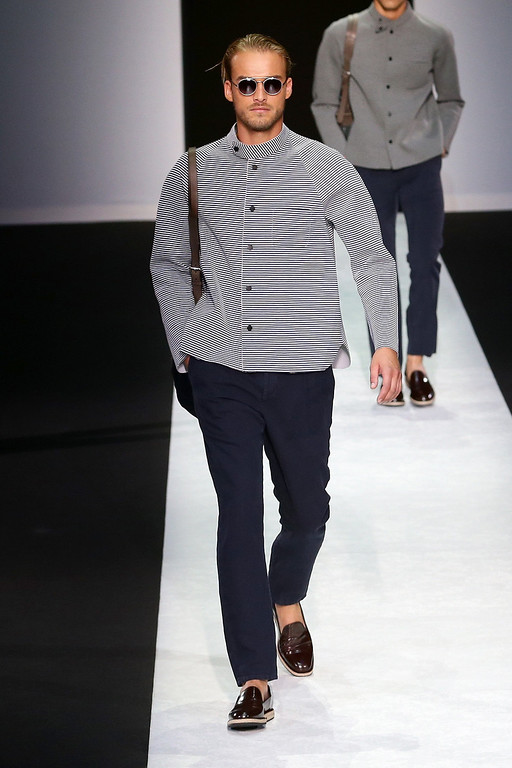 . A model walks the runway at the Giorgio Armani show during Milan Menswear Fashion Week Spring Summer 2014 on June 25, 2013 in Milan, Italy.  (Photo by Vittorio Zunino Celotto/Getty Images)