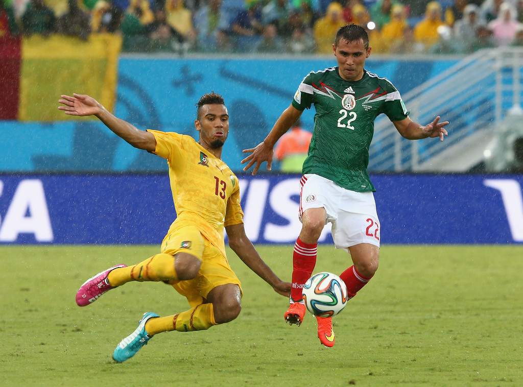 . Maxim Choupo-Moting of Cameroon battles with Paul Aguilar of Mexico during the 2014 FIFA World Cup Brazil Group A match between Mexico and Cameroon at Estadio das Dunas on June 13, 2014 in Natal, Brazil.  (Photo by Jamie Squire/Getty Images)
