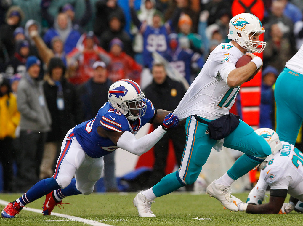 . Miami Dolphins quarterback Ryan Tannehill (17) is sacked by Buffalo Bills strong safety Da\'Norris Searcy (25) during the first half of an NFL football game on Sunday, Dec. 22, 2013, in Orchard Park, N.Y. (AP Photo/Bill Wippert)