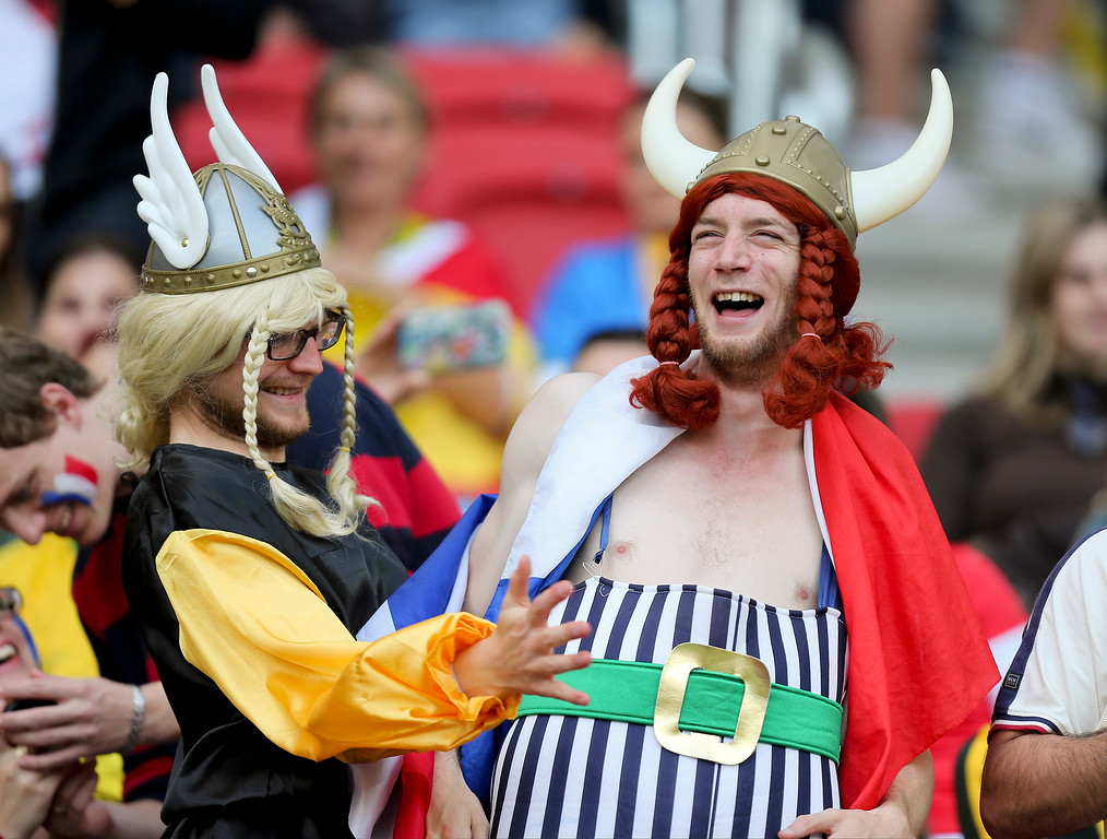 . French supporters react before the group E World Cup soccer match between France and Honduras at the Estadio Beira-Rio in Porto Alegre, Brazil, Sunday, June 15, 2014. (AP Photo/David Vincent)