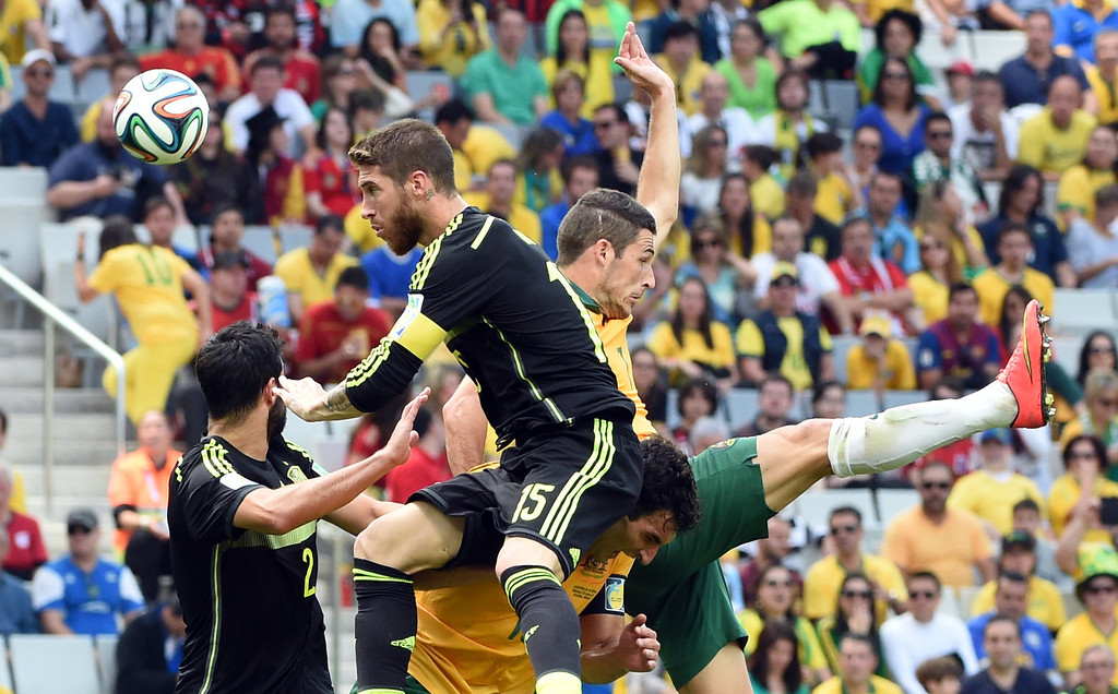 . (FromL) Spain\'s defender Raul Albiol, Spain\'s defender Sergio Ramos, Australia\'s forward Mathew Leckie and Australia\'s midfielder Mile Jedinak jump for the ball during a Group B football match between Australia and Spain at the Baixada Arena in Curitiba during the 2014 FIFA World Cup on June 23, 2014.  AFP PHOTO / WILLIAM  WEST/AFP/Getty Images