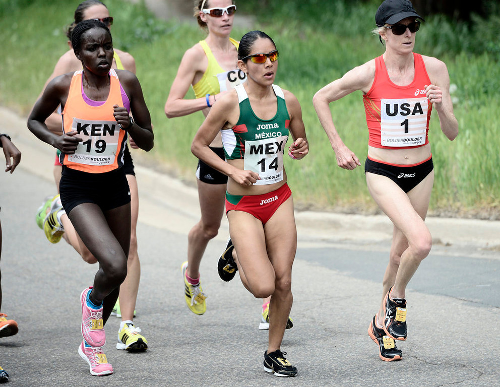 . Team USA\'s  Deena Kastor battles with Madai Perez Carrillo, of Mexico, center and Kenya\'s  Chemtai Rionotukei during the 2013 Bolder Boulder in Boulder Colorado.  Photo by Paul Aiken / The Boulder Daily Camera / May 27, 2013