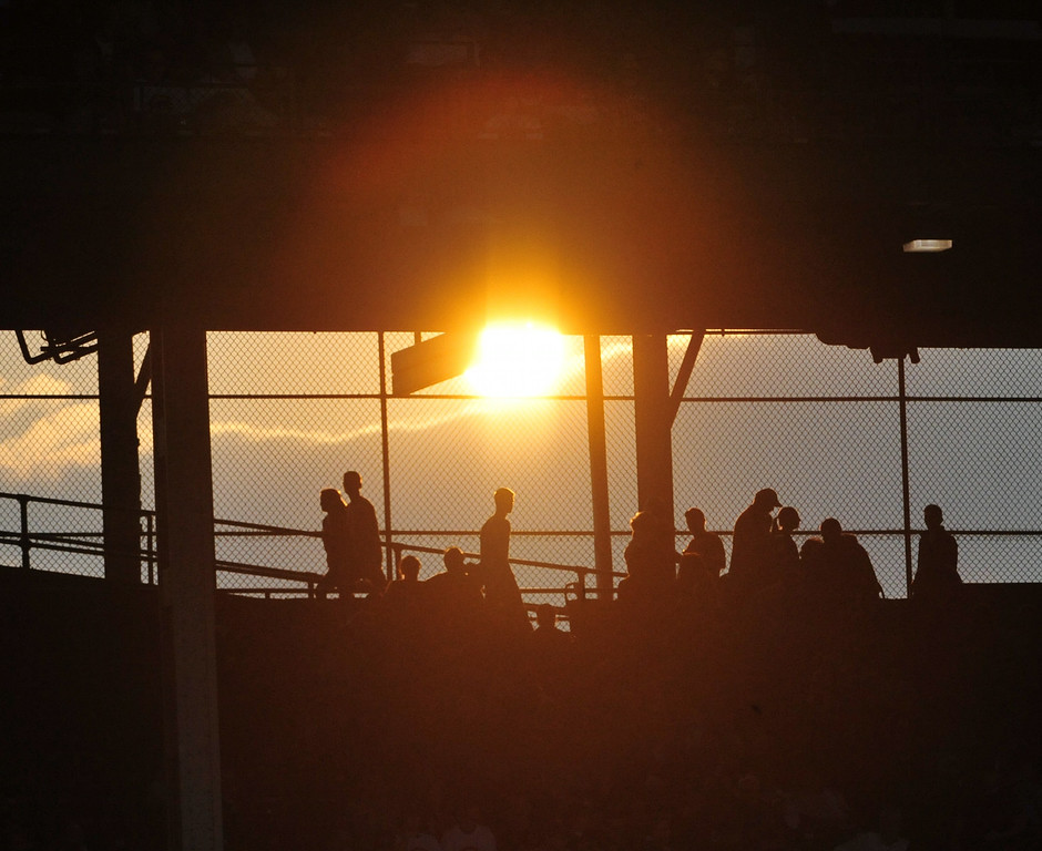 . CHICAGO, IL - JULY 30: Fans walk through the ballpark as the sun goes down during the second inning in a game between the Chicago Cubs and the Colorado Rockies on July 30, 2014 at Wrigley Field in Chicago, Illinois. (Photo by David Banks/Getty Images)