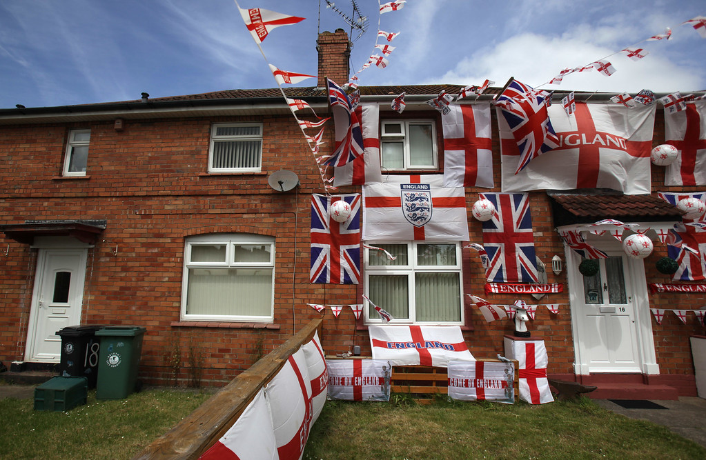 . England flags adorn a house in a street in the Knowle West area of Bristol on June 11, 2014 in Bristol, England. The football World Cup, which kicks off in Sao Paulo on June 12, 2014 with Brazil versus Croatia, has been beset by construction delays, protests and strikes. However, despite the problems and the fact that it is being hosted 1000s of miles away in Brazil the tournament is being widely anticipated throughout the UK with many homes, business and cars beginning to  display England flags and other football paraphernalia.  (Photo by Matt Cardy/Getty Images)