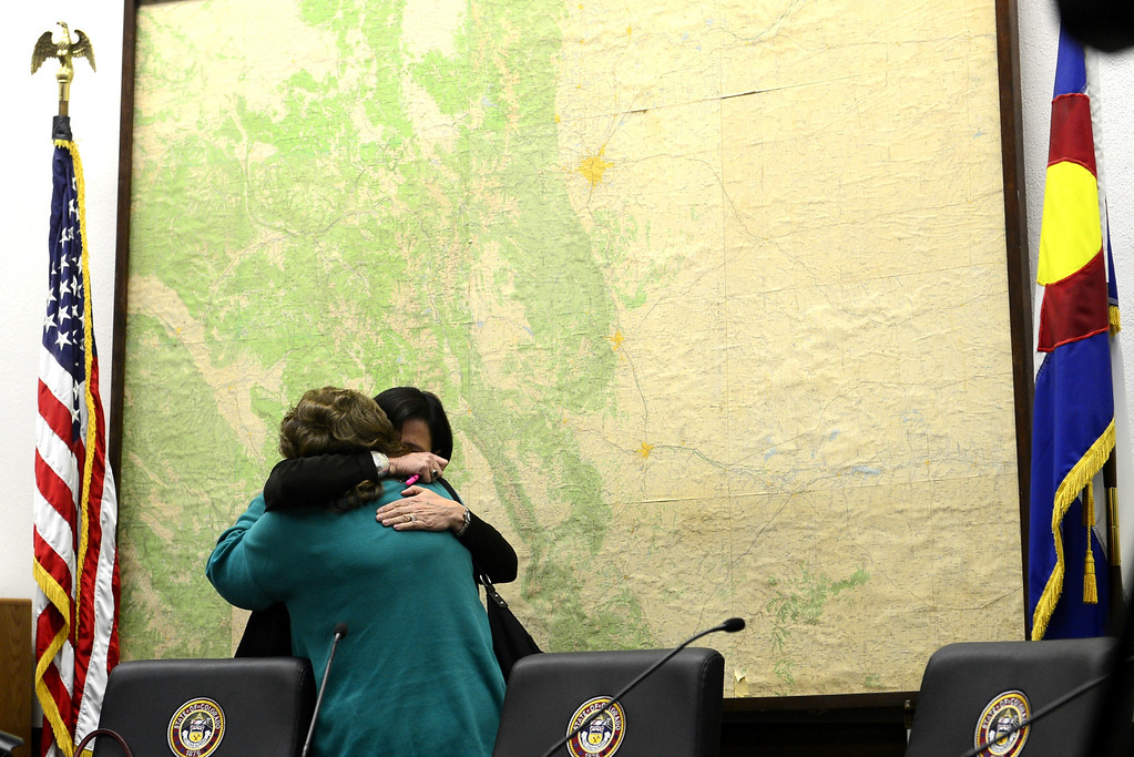 . DENVER, CO - MARCH 4: Sen. Evie Hudak (right) and Sen. Angela Giron hug after voting yes to ban concealed to carry guns on college campuses at the State Capitol. Four gun bills were up for debate. (Photo by AAron Ontiveroz/The Denver Post)