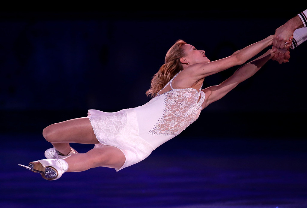 . Tatiana Volosozhar and Maxim Trankov of Russia perform during the figure skating exhibition gala at the Iceberg Skating Palace during the 2014 Winter Olympics, Saturday, Feb. 22, 2014, in Sochi, Russia. (AP Photo/Bernat Armangue)