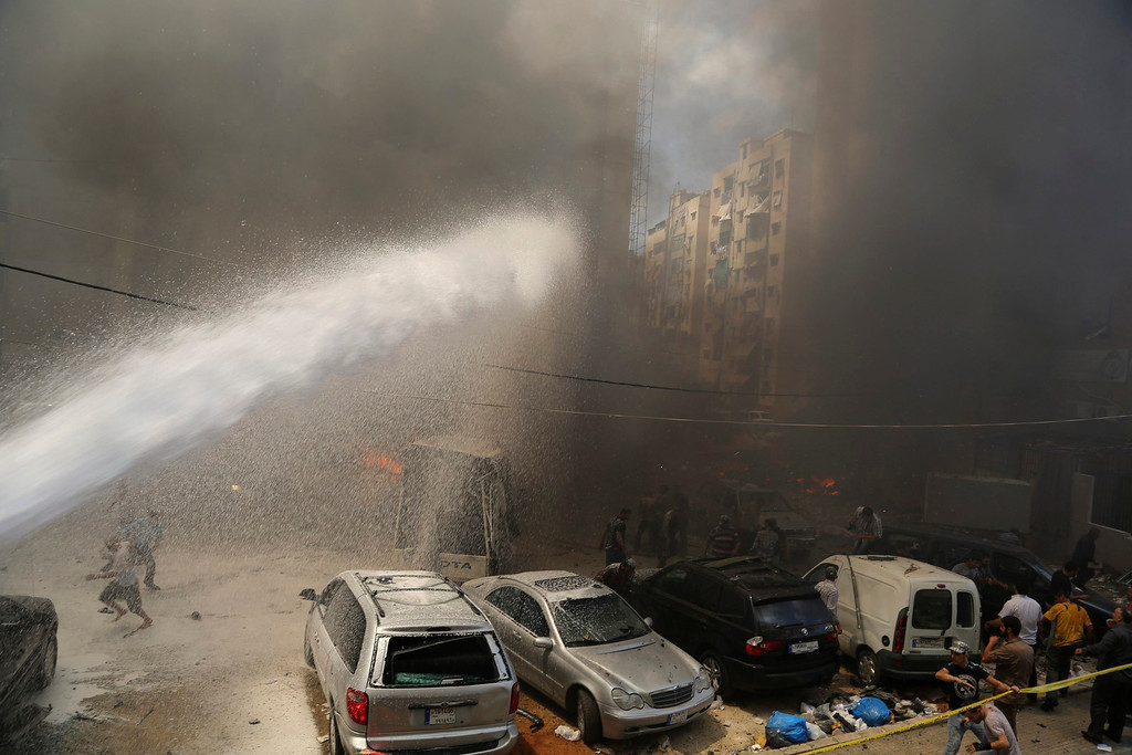 . Civil Defense members extinguish fire at the site of an explosion in Beirut\'s southern suburbs July 9, 2013. REUTERS/Issam Kobeisi