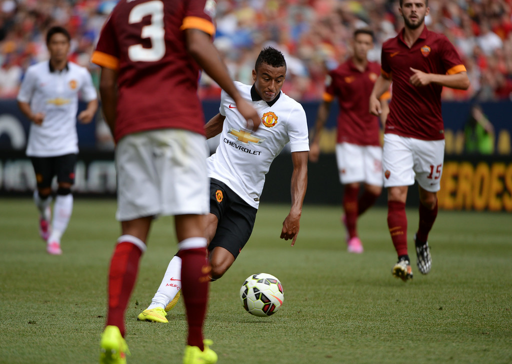 . Jesse Lingard of Manchester United (35) controls the ball against AS Roma defense during the 2nd half of Guinness International Champions Cup 2014 at Sports Authority Field at Mile High in Denver, Colorado,  July 26, 2014. (Photo by Hyoung Chang/The Denver Post)