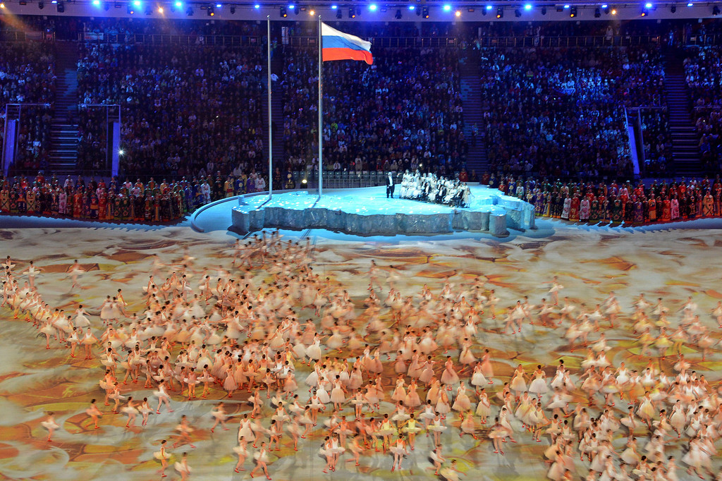 . Artists perform under the flag of Russia in the Fisht Olympic Stadium during the opening ceremony of the 2014 Winter Paralympic Games in the Black Sea resort of Sochi on March 7, 2014. AFP PHOTO / KIRILL KUDRYAVTSEV/AFP/Getty Images