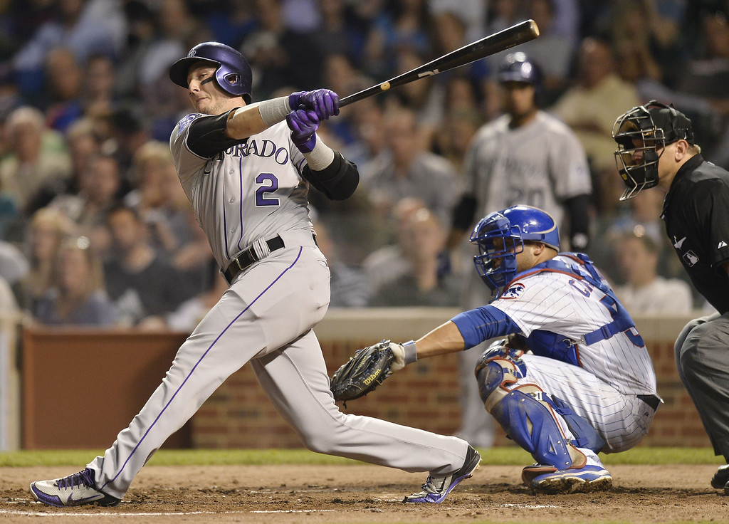. Troy Tulowitzki #2 of the Colorado Rockies hits an RBI double, scoring Carlos Gonzalez (not pictured) as Welington Castillo #53 of the Chicago Cubs catches during the fifth inning on May 14, 2013 at Wrigley Field in Chicago, Illinois.  (Photo by Brian Kersey/Getty Images)