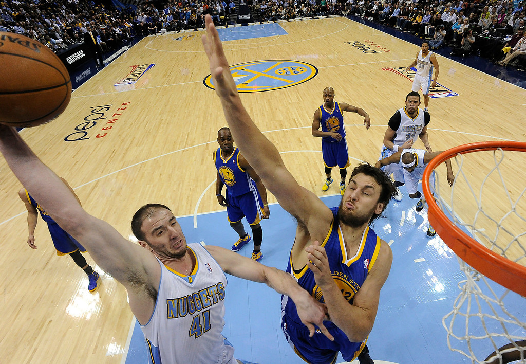 . Denver Nuggets center Kosta Koufos (41) puts up a shot against Golden State Warriors center Andrew Bogut (12). The Denver Nuggets took on the Golden State Warriors in Game 5 of the Western Conference First Round Series at the Pepsi Center in Denver, Colo. on April 30, 2013. (Photo by John Leyba/The Denver Post)