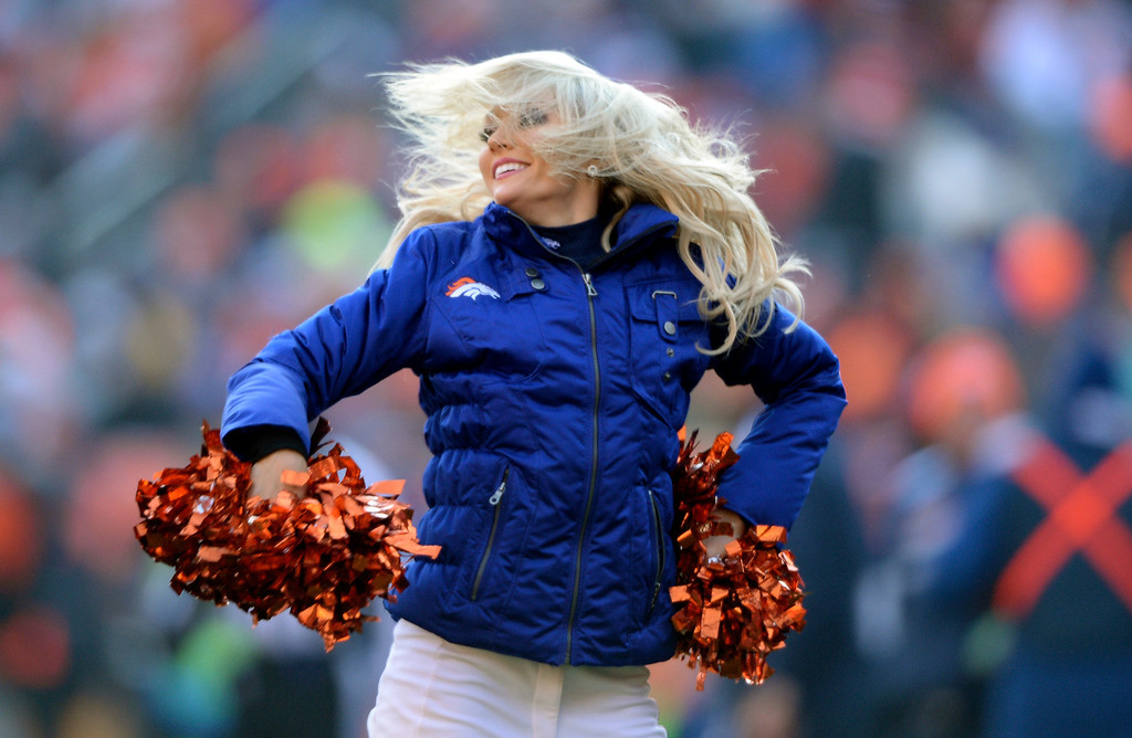 . Denver Broncos cheerleaders dance during the first quarter.  The Denver Broncos vs. the Tennessee Titans at Sports Authority Field at Mile High in Denver on December 8, 2013. (Photo by Hyoung Chang/The Denver Post)