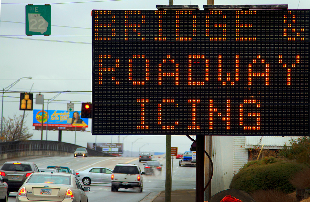 . A sign alongside 13th Street near 10th Avenue in Columbus, Ga., warns westbound motorists Tuesday, Jan. 28, 2015 of potential icing on the bridge due to wintry precipitation. Georgians stocked up on ice-melting chemicals, school systems closed, and road crews prepared to clear snow and ice from highways as a winter storm took aim. (AP Photo/Columbus Ledger, Mike Haskey)