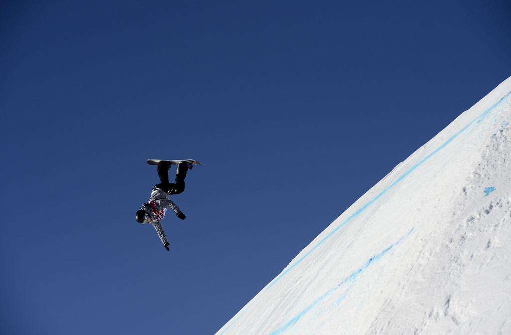 . Austria\'s Mathias Weissenbacher competes in the Men\'s Snowboard Slopestyle 1st heat qualification at the Rosa Khutor Extreme Park during the Sochi Winter Olympics on February 6, 2014.  AFP PHOTO / FRANCK  FIFE/AFP/Getty Images