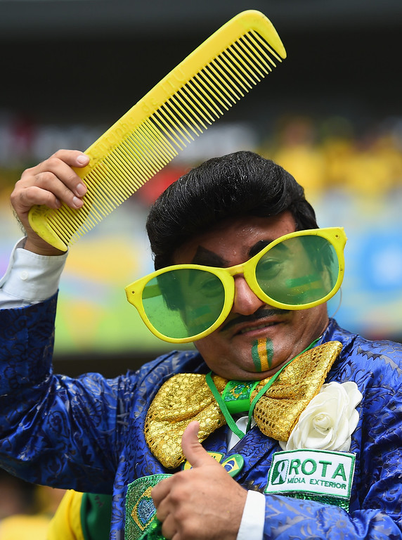 . FORTALEZA, BRAZIL - JUNE 17:  A Brazil fans poses before the 2014 FIFA World Cup Brazil Group A match between Brazil and Mexico at Castelao on June 17, 2014 in Fortaleza, Brazil.  (Photo by Laurence Griffiths/Getty Images)