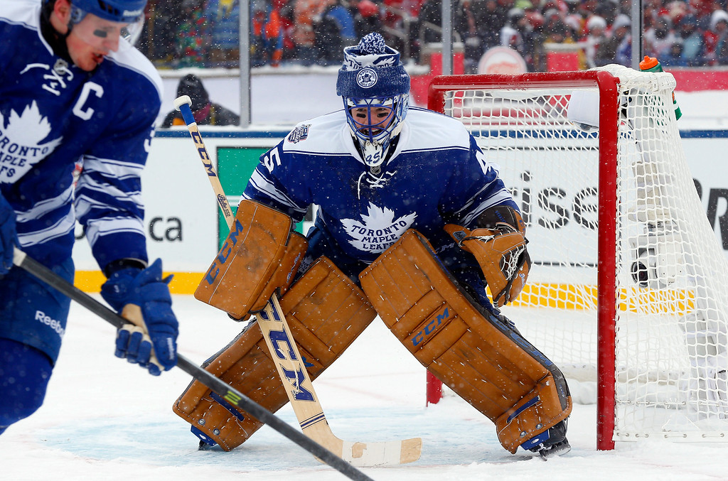 . Toronto Maple Leafs goalie Jonathan Bernier (45) guards the net during the second period of the Winter Classic outdoor NHL hockey game against the Detroit Red Wings at Michigan Stadium in Ann Arbor, Mich., Wednesday, Jan. 1, 2014. (AP Photo/Paul Sancya)