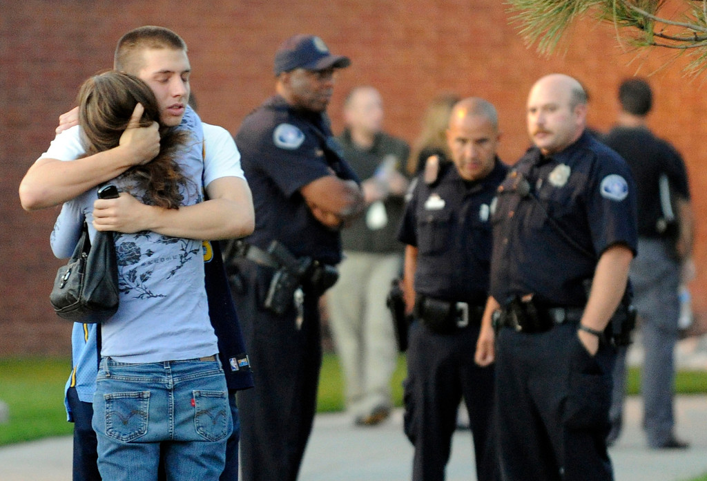 . Tammi Stevens, is overcome with emotion as she picks up her son, Jacob Stevens, outside Gateway High School, Friday July 20, 2012, in Aurora. Jacob was a witnesses to a shooting, where 12 people were fatally shot inside an Aurora movie theater during a premiere showing of the new Batman movie. RJ Sangosti, The Denver Post