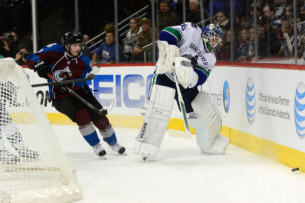 . DENVER, CO - MARCH 24: Cory Schneider (35) of the Vancouver Canucks clears the puck as Matt Duchene (9) of the Colorado Avalanche defends during the first period of action. Colorado Avalanche versus the Vancouver Canucks at the Pepsi Center. (Photo by AAron Ontiveroz/The Denver Post)
