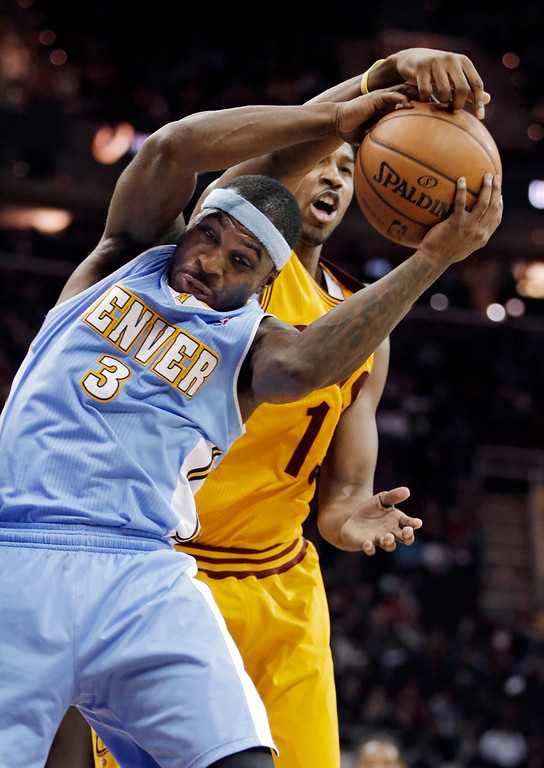 . Denver Nuggets\' Ty Lawson (3) challenges Cleveland Cavaliers\' Tristan Thompson for a rebound in the fourth quarter of an NBA basketball game Saturday, Feb. 9, 2013, in Cleveland. Denver won 111-103. (AP Photo/Mark Duncan)