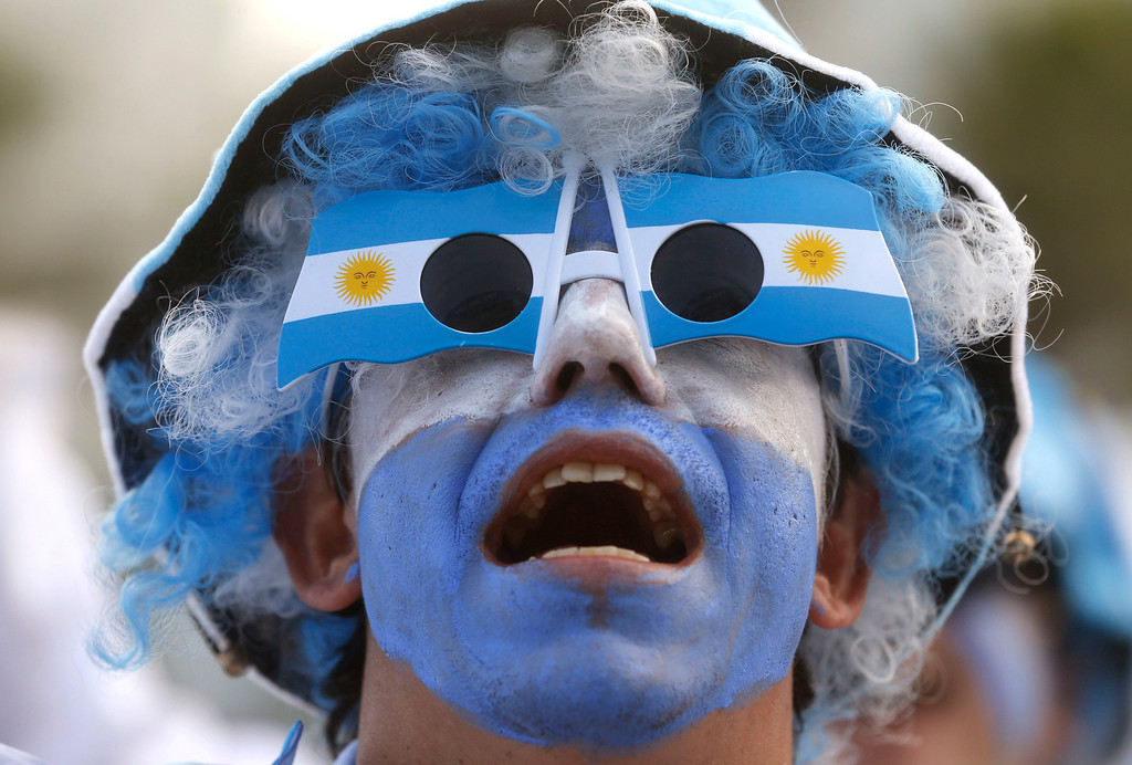 . An Argentina soccer fan watches his team\'s World Cup match with Iran at a live telecast inside the FIFA Fan Fest area on Copacabana beach, in Rio de Janeiro, Brazil, Saturday, June 21, 2014. Argentina won 1-0. (AP Photo/Silvia Izquierdo)
