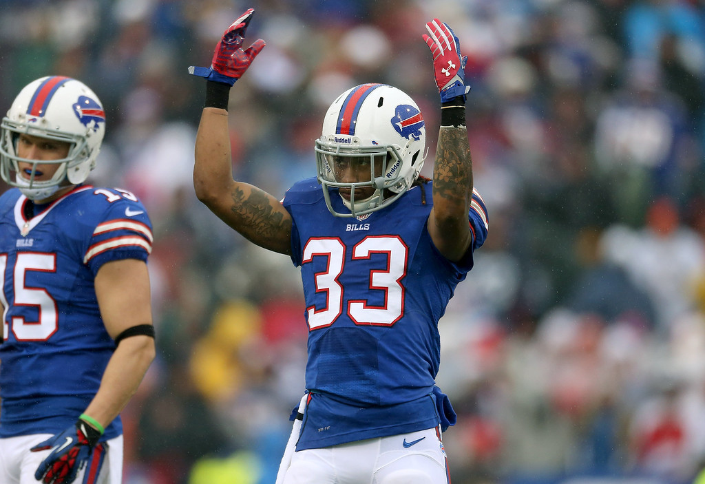 . Ron Brooks #33 of the Buffalo Bills tries to get the crowd involved during NFL game action against the Miami Dolphins at Ralph Wilson Stadium on December 22, 2013 in Orchard Park, New York. (Photo by Tom Szczerbowski/Getty Images)