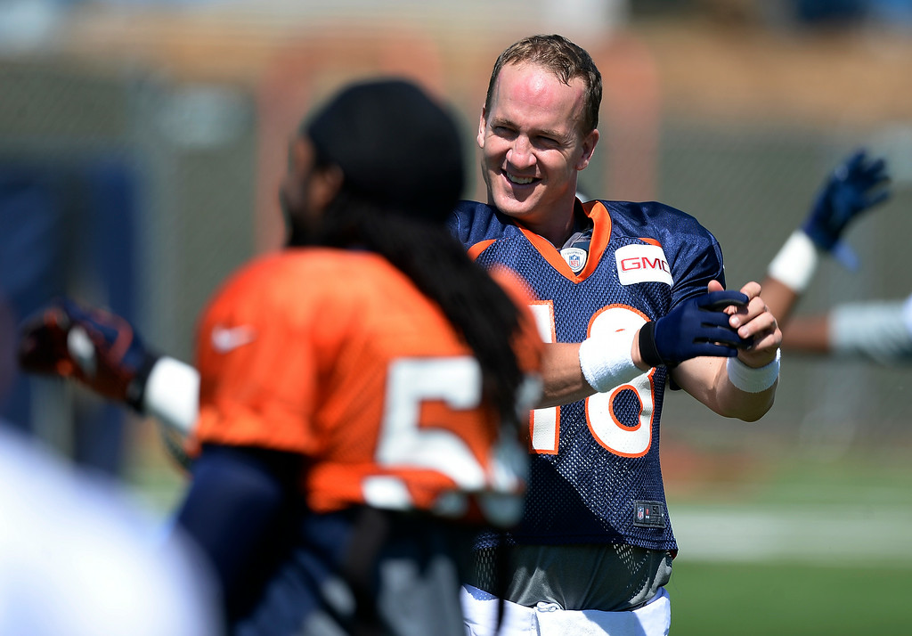 . Denver Broncos quarterback Peyton Manning (18) stretches before practice at the Denver Broncos 2014 training camp August 11, 2014 at Dove Valley. (Photo by John Leyba/The Denver Post)