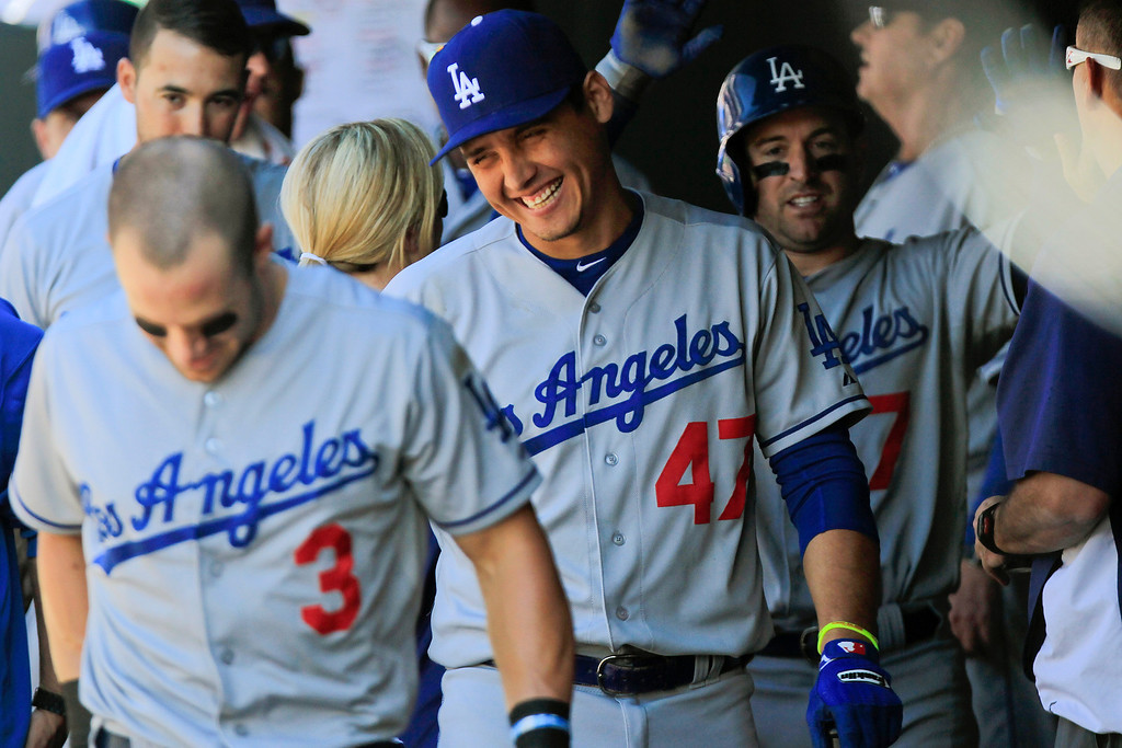 . Los Angeles Dodgers Luis Cruz (47) smiles with teammates after they scored  the go ahead run on a double by Tim Federowicz during the sixth inning of the MLB National League baseball game Saturday June 1, 2013 in Denver. (AP Photo/Barry Gutierrez)