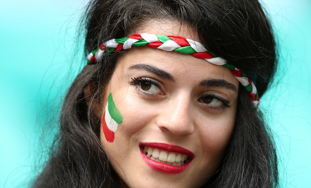 . A fan of Iran poses before a Group F football match between Bosnia-Hercegovina and Iran at the Fonte Nova Arena in Salvador during the 2014 FIFA World Cup on June 25, 2014.    AFP PHOTO / BEHROUZ MEHRI/AFP/Getty Images