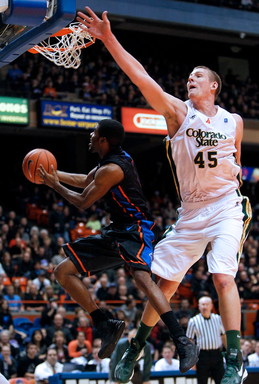 . Boise State guard Michael Thompson (1) drives under pressure from Colorado State center Colton Iverson during an NCAA college basketball game in Boise, Idaho, Saturday, March 2, 2013.  (AP Photo/Darin Oswald)