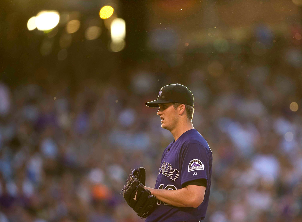 . Colorado Rockies\'  Drew Pomeranz #13 prepares to throw a pitch during the fourth inning of a Major League Baseball game against the Miami Marlins on July 22, 2013 at Coors Field in Denver. (Photo By Grant Hindsley/The Denver Post)