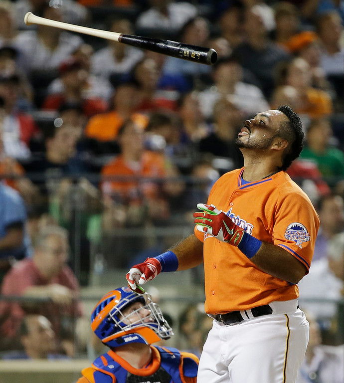 . National League\'s Pedro Alvarez, of the Pittsburgh Pirates, tosses after his at bat during the MLB All-Star baseball Home Run Derby, on Monday, July 15, 2013 in New York. (AP Photo/Matt Slocum)