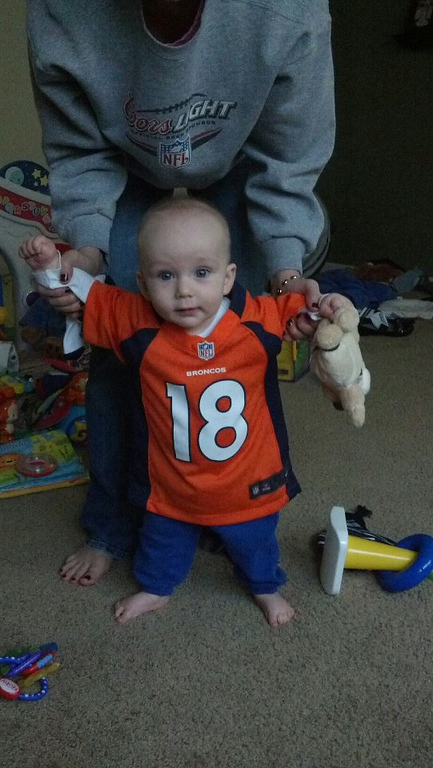 . Our 6 month old showing his Bronco Pride!! Matt