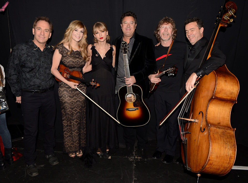 . NASHVILLE, TN - NOVEMBER 06:  (EXCLUSIVE COVERAGE) Eric Darken, Alison Krauss,Taylor Swift, Vince Gill, Sam Bush and Edgar Myer pose backstage at the 47th annual CMA Awards at the Bridgestone Arena on November 6, 2013 in Nashville, Tennessee.  (Photo by Jason Davis/Getty Images For CMA Awards)