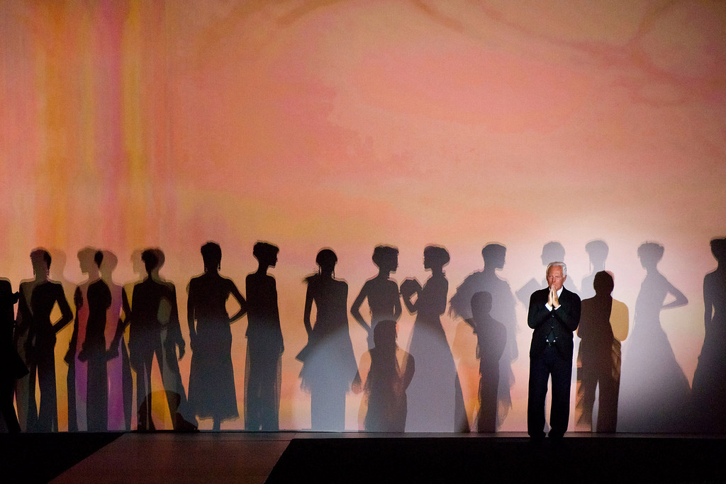 ". Giorgio Armani takes a bow at the conclusion of his ""One Night Only New York� fashion show on Thursday, Oct. 24, 2013 in New York. (Photo by Charles Sykes/Invision/AP)"